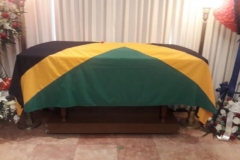 Flag draped casket for the late Gladstone Plunkett