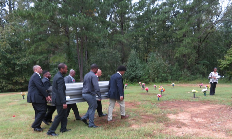 Pallbearers carrying the  casket for the late Levi Bowen to his final resting place