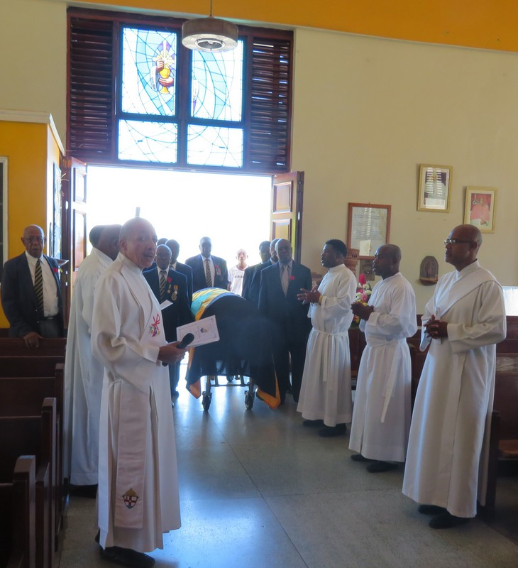 Rev. Deacon Baldwin Powell with other Clergy members conducting the reception for the late Lloyd Tapping