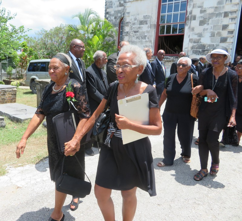 Mrs. Charlton (L) & family members led well-wishers from the St. James Parish Church following the thanksgiving service for Ex-RAFA Roderick G Charlton