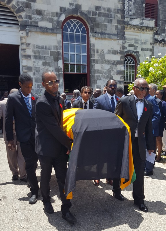 Family members carried the casket for the late Ex-RAFA Stanford W Miles form the church following the service of thanksgiving