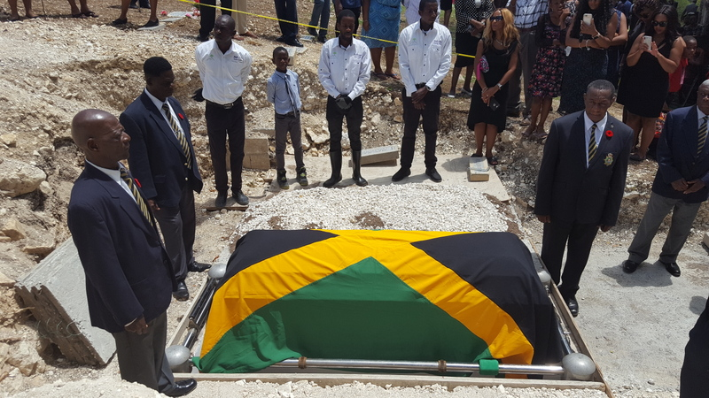 Members of the Montego Bay Branch Jamaica Legion prepare to remove the flag at the interment for the late Ex-RAFA Stanford W Miles