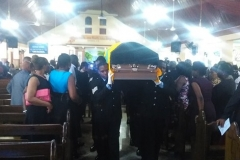 Tomlin Smith's casket carried from the church by pallbearers from the Jamaica Fire Brigade 2015