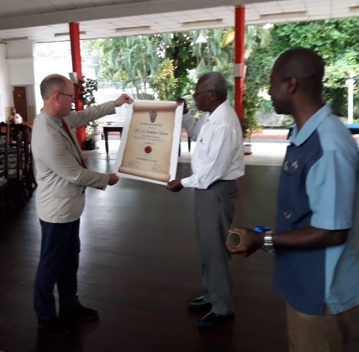 Mr. Renard Henry, member of the Benevolent Committee making a presentation to Secretary General Lt. Col. Warren.